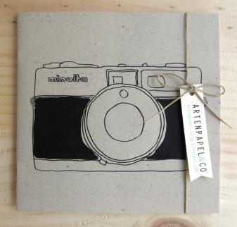 libreta cámara fotos