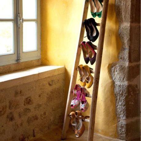 zapatero en una escalera